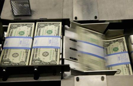 United States one dollar bills are put in packaging bands during production at the Bureau of Engraving and Printing in Washington