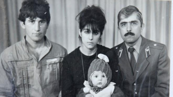 Baby Tamerlan Tsarnaev (center) poses with his mother, father (left) and uncle in this undated photo.