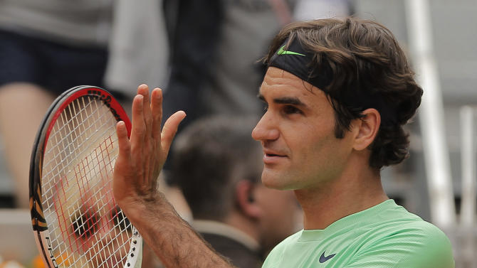 Roger Federer from Switzerland celebrates his victory during the match against Radek Stepanek from Czech Republic at the Madrid Open tennis tournament in Madrid, Tuesday, May 7, 2013. (AP Photo/Andres Kudacki)