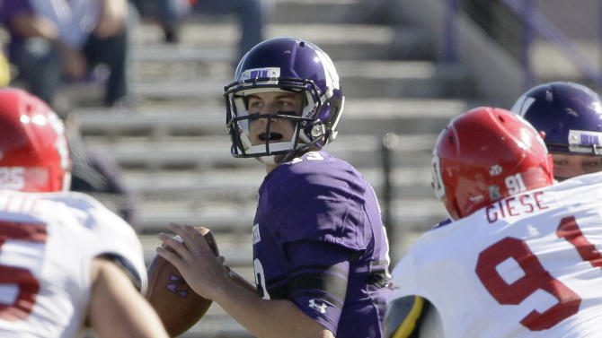 Northwestern quarterback Trevor Siemian (13) looks to a pass during the first half of an NCAA college football game against South Dakota in Evanston, Ill., Saturday, Sept. 22, 2012. (AP Photo/Nam Y. Huh)