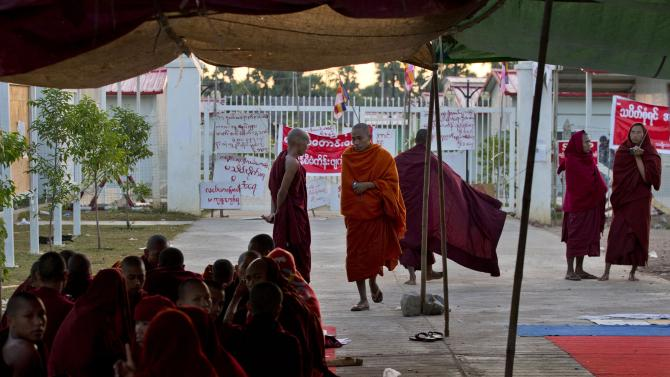 Protesting Buddhist monks occupy the office entrance to the Chinese mine company Wan Bao Co. Ltd. in Letpadaung mine, Monywa township, northwestern Myanmar, Wednesday, Nov. 28, 2012. Hundreds of Buddhist monks and villagers occupying the mine, they said is causing environmental, social and health problems, defied a government order to leave by Wednesday, saying they will stay until the project is halted. (AP Photo/Gemunu Amarasinghe)