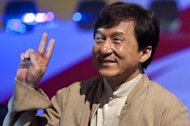 "This file photo shows Hong Kong action star, Jackie Chan, flashing a V sign during a promotional event in Brazil, on February 3, 2012. Chan this week joins China's top political advisory body in a move analysts say highlights Beijing's growing ""soft power"" efforts to project unity between itself and the former British colony"