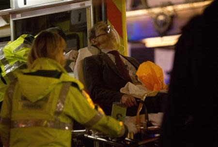 A man receives medical attention after part of the ceiling at the Apollo Theatre on Shaftesbury Avenue collapsed in central London