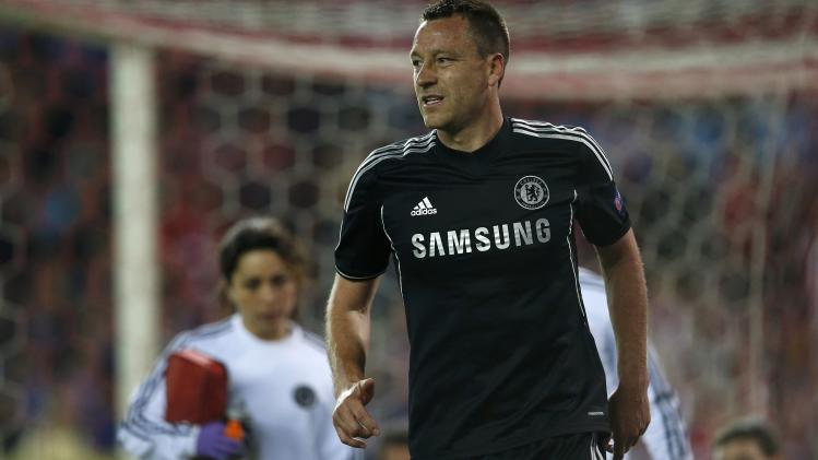 Chelsea's Terry reacts as he walks on the pitch after being injured during their Champions League semi-final first leg soccer match against Atletico Madrid at Vicente Celderon Stadium in Madrid