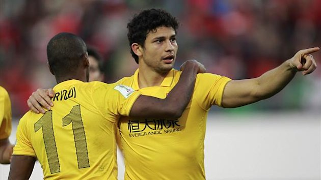 Elkeson (R) of China's Guangzhou Evergrande gestures as he celebrates his goal against Egypt's Al Ahly with his team mate Muriqui during their FIFA Club World Cup soccer match, at Agadir Stadium in Agadir December 14, 2013. REUTERS