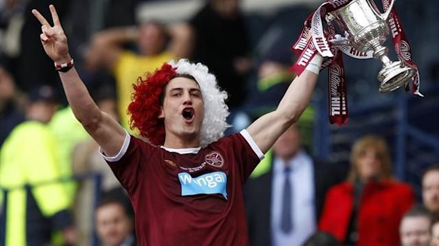 Hearts' Rudi Skacel celebrates with his teammates as he lifts the Scottish Cup winner's trophy (Reuters)