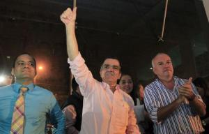 Colombian presidential candidate Oscar Ivan Zuluaga gestures during a campaign rally in Cali