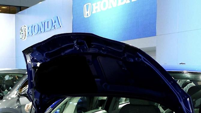 FILE -In this Nov. 16, 2011, file photo, Honda Motor Co.'s 2013 Fit EV, is officially unveiled at the Los Angeles Auto Show in Los Angeles.  Honda said Wednesday, June 6, 2012, that the 2013 Fit EV has received the highest fuel efficiency rating ever from the Environmental Protection Agency. (AP Photo/The Yomiuri Shimbun, Taro Koyano)