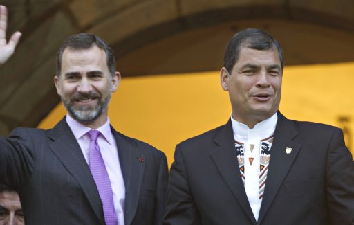 Ecuador's President Correa joined by Spain's Crown Prince Felipe greet people from a balcony at Carondelet Palace in Quito