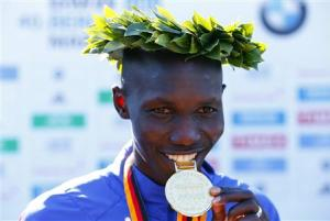 Kipsang of Kenya poses during victory ceremony after winning 40th Berlin marathon