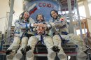 European Space Agency astronaut Parmitano, NASA astronaut Nyberg and Russian cosmonaut Yurchikhin join hands before training examination at the Star City space centre outside Moscow