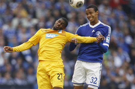 Schalke 04's Matip and Hoffenheims Modeste head a ball during the German first division Bundesliga soccer match in Gelsenkirchen