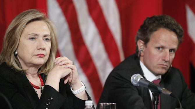 In this photo taken May 10, 2011, U.S. Secretary of State Hillary Rodham Clinton, left, and Treasury Secretary Timothy Geithner listen near the end of a joint meeting of the U.S.-China Strategic and Economic Dialogue (S&ED), at the Department of the Interior in Washington. Attention returns to China this coming week when Clinton and Geithner attend strategic and economic talks in Beijing.  (AP Photo/Alex Brandon)