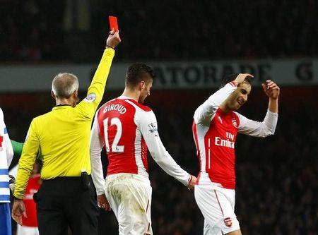 Referee Martin Atkinson shows Arsenal's Olivier Giroud the red card during their English Premier League soccer match against Queens Park Rangers at the Emirates Stadium in London