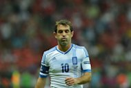 Greece coach Fernando Santos named a 21-man squad for next week's friendly with Norway, leaving out Euro 2012 captain and scorer of the winning goal against Russia, veteran midfielder Giorgos Karagounis, seen here in June 2012