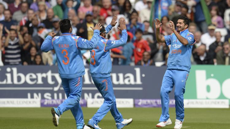 India's Sharma is congratulated by team-mates after running out England's Bell during the third one-day international cricket match at Trent Bridge cricket ground, Nottingham
