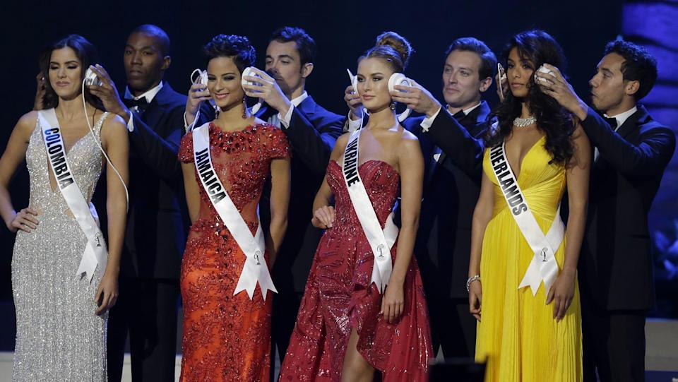 From left, Miss Colombia Paulina Vega, Miss Jamaica  Kaci Fennell, Miss Ukraine Diana Harkusha, and Miss Netherlands Yasmin Verheijen have they're...