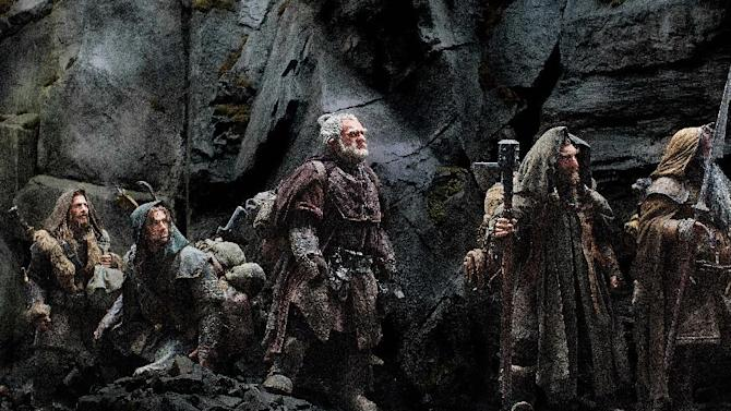 """This publicity film image released by Warner Bros., shows, from left: Dean O'Gorman as Fili; Aidan Turner as Kili; Mark Hadlow as Dori; Jed Brophy as Nori; and William Kircher as Bifur, in a scene from the fantasy adventure """"The Hobbit: An Unexpected Journey."""" (AP Photo/Warner Bros, File)"""