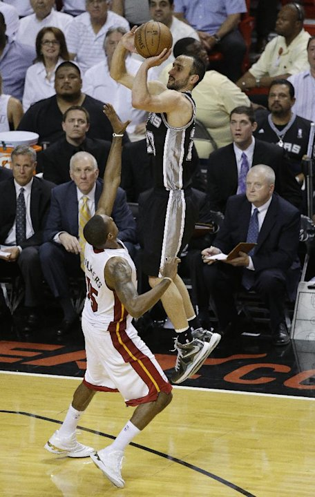 San Antonio Spurs shooting guard Manu Ginobili (20) of Argentina shoots against Miami Heat point guard Mario Chalmers (15) during the second half of Game 6 of the NBA Finals basketball game, Tuesday,