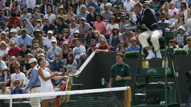 Jelena Jankovic of Serbia talks to the umpire during her match against Agnieszka Radwanska of Poland at the Wimbledon Tennis Championships in London