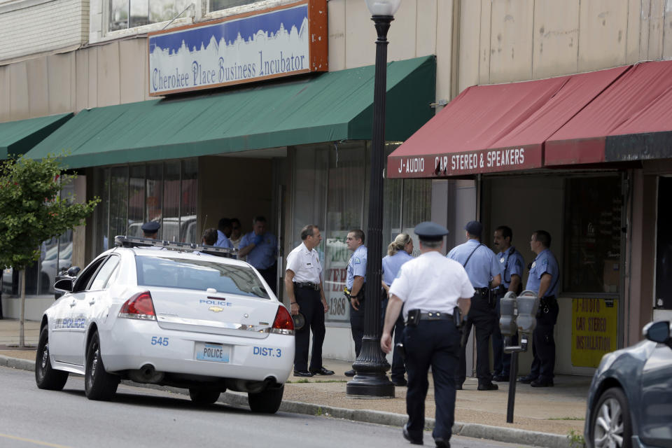 Police work at the scene of a shooting Thursday, June 13, 2013, in St. Louis. St. Louis police say an argument inside a business south of downtown escalated into gun violence, with a man shooting three other people before turning the gun on himself. (AP Photo/Jeff Roberson)