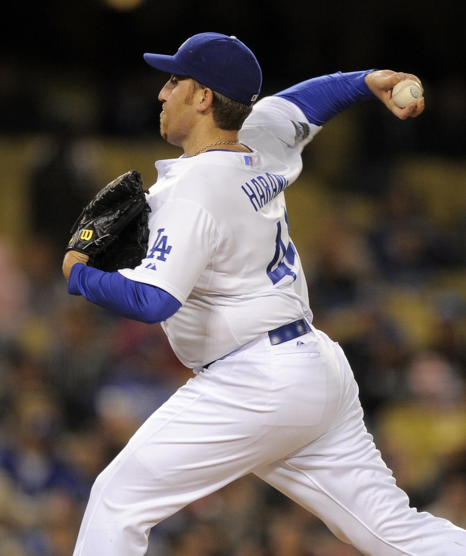 Los Angeles Dodgers starting pitcher Aaron Harang throws to the plate during the seventh inning of their baseball game against the San Diego Padres, Friday, April 13, 2012, in Los Angeles. (AP Photo/Mark J. Terrill)