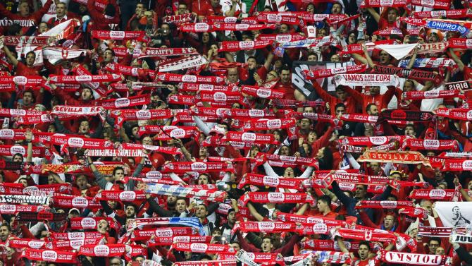 Sevilla fans celebrate after Sevilla won 3-2 during the final of the soccer Europa League between FC Dnipro Dnipropetrovsk and Sevilla FC at the National Stadium in Warsaw, Poland, Wednesday, May 27, 2015. (AP Photo/Czarek Sokolowski)