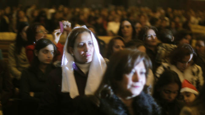 Egyptian Christians listen to a  midnight Mass led by Pope Tawadros II, the 118th pope of the Coptic Church of Egypt, unseen, on the eve of Orthodox Christmas at St. Mark's Cathedral in Cairo, Egypt, late Sunday, Jan. 6, 2013 . (AP Photo/Amr Nabil)