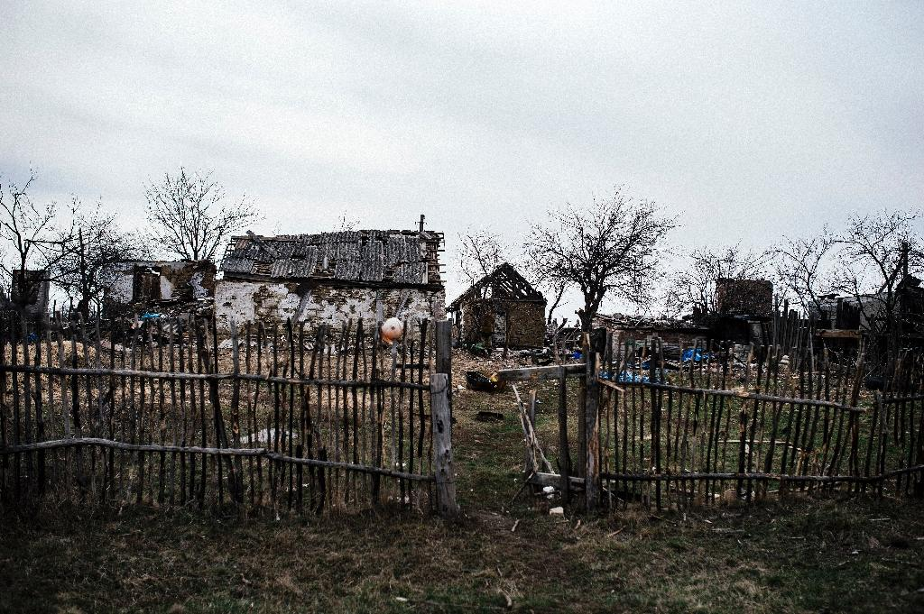 Ravaged east Ukraine village reveals cost of war