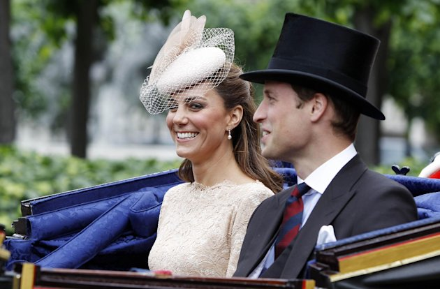 Britain's Prince William and his wife Kate, Duchess of Cambridge take an open top carriage ride through the streets of London after a Diamond Jubilee Luncheon given for The Queen, Tuesday June 5, 2012