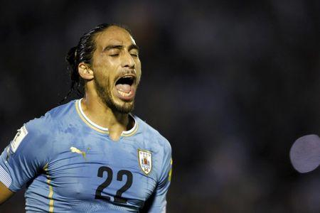 Uruguay's Caceres reacts after scoring against Chile during their 2018 World Cup qualifying soccer match in Montevideo