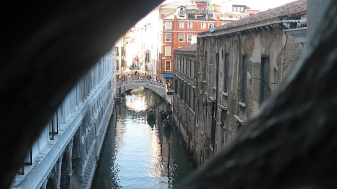 This July 17, 2012 photo shows a view from the Bridge of Sighs onto the canals of Venice, Italy. To travel through northern Italy with a copy of Mark Twain's 1869 ''The Innocents Abroad', his classic 'record of a pleasure trip'. It took him to the great sights of Europe and on to Constantinople and Jerusalem before he sailed home to New York. Such a trip would take far too big a chunk out of my holiday time. But, Milan, Florence and Venice, a mere fragment for Twain, was within my reach for a two-week vacation. (AP Photo/Raf Casert)