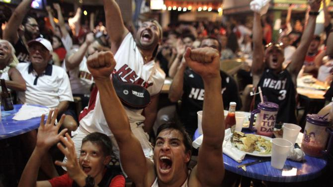 Miami Heat fans react while watching the Game 7 in the NBA Finals between the Heat and the San Antonio Spurs in Miami, on Thursday, June 20, 2013. (AP Photo/Javier Galeano)