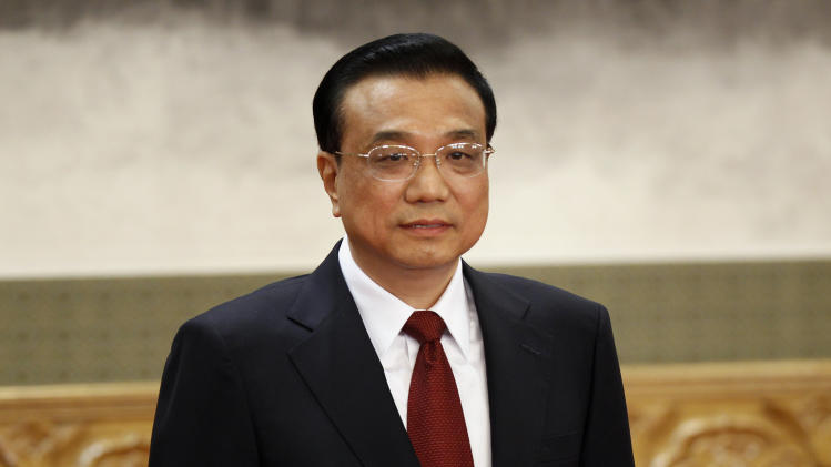 Li Keqiang, one of the seven newly elected members of the Politburo Standing Committee, attends a press event at Beijing's Great Hall of the People, Thursday Nov. 15, 2012. The seven-member Standing Committee, the inner circle of Chinese political power, was paraded in front of assembled media on the first day following the end of the 18th Communist Party Congress. (AP Photo/Vincent Yu)
