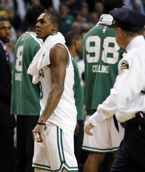 Boston Celtics' Rajon Rondo, center, walks off the court after being ejected in the second quarter of an NBA basketball game against the Brooklyn Nets in Boston, Wednesday, Nov. 28, 2012. (AP Photo/Michael Dwyer)