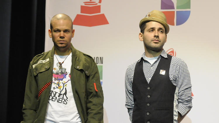Rene Perez Joglar, left, and Eduardo Cabra Martinez of the hip-hop duo Calle 13 look on during the 12th Annual Latin Grammy Nomination Announcement news conference in Los Angeles on Wednesday, Sept. 14, 2011. Calle 13 received 10 nominations. (AP Photo/Dan Steinberg)