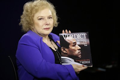 In this Tuesday, June 3, 2014 photo, Associated Press reporter Linda Deutsch poses for a photo with her book Verdict, The Chronicle of the O.J. Simpso...