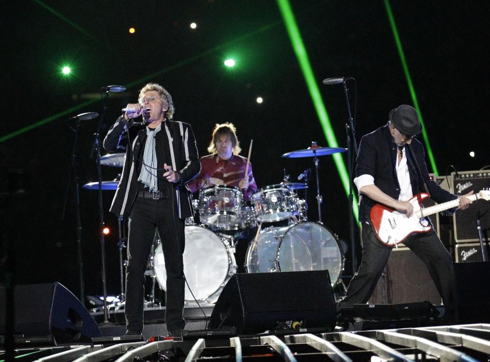 FILE - In this Feb. 7, 2010 file photo Roger Daltrey, left, Zak Starkey, center, and Pete Townshend of The Who perform during halftime of the NFL Super Bowl XLIV football game between the Indianapolis Colts and New Orleans Saints in Miami. (AP Photo/David J. Phillip, File)