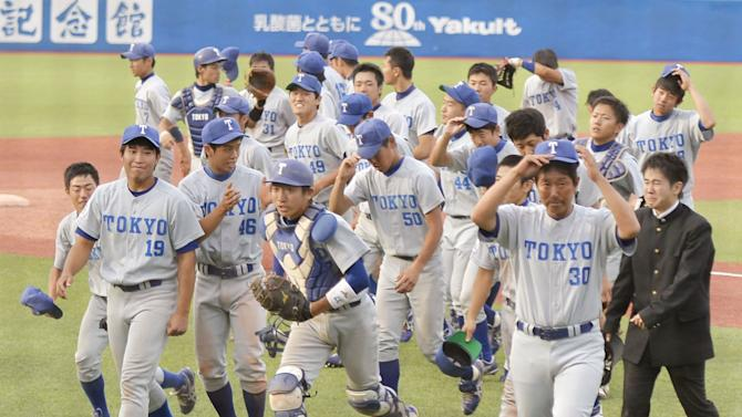 The University of Tokyo players leave the ground in joy after putting an end to a record 94-game losing streak, winning for the first time in five years, during the Tokyo Big 6 Baseball League match against Hosei University at Jingu Stadium in Tokyo Saturday, May 23, 2015. The University of Tokyo beat Hosei 6-4 to win its first game since Oct. 2, 2010. (AP Photo/Yohei Nishimura/Kyodo News via AP) JAPAN OUT, CREDIT MANDATORY