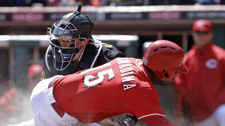 Cincinnati Reds' Roger Bernadina (15) is tagged out at home by Pittsburgh Pirates catcher Tony Sanchez in the eighth inning of a baseball game, Wednesday, April 16, 2014, in Cincinnati. Cincinnati won 4-0