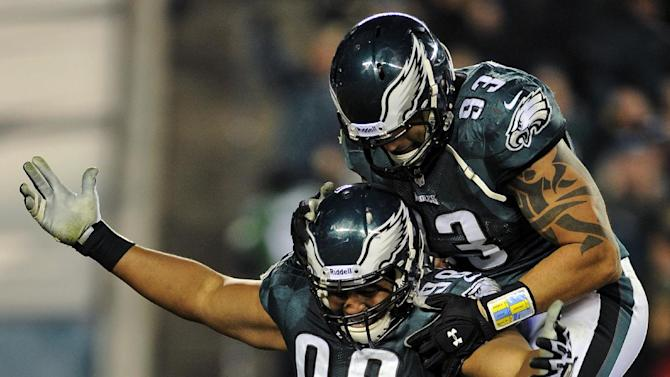 Philadelphia Eagles defensive tackle Mike Patterson (98) and defensive end Jason Babin (93) celebrate after Patterson sacked Carolina Panthers quarterback Cam Newton in the second half of an NFL football game, Monday, Nov. 26, 2012, in Philadelphia. (AP Photo/Michael Perez)