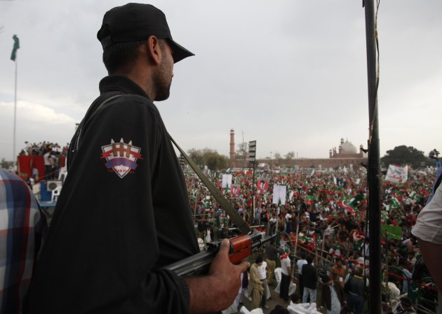 A policeman stands guard during a rally by political party Pakistan Tehreek-e- Insaf (PTI) in Lahore