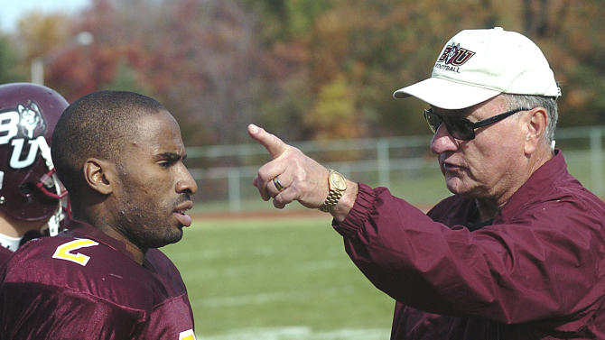 "In this Nov. 3, 2007, photo, Ed Rush, right, a football coach at Bloomsburg University, talks with receiver Brahin Bilal during practice in Bloomsburg, Pa. Rush has resigned as the Pac-12 Conference's coordinator of basketball officials following comments that he targeted Arizona coach Sean Miller during internal meetings before the conference tournament. Pac-12 Commissioner Larry Scott said in a statement released Thursday, April 4, 2013, that ""I want to express my appreciation for the great contribution Ed made to basketball officiating for the Conference during his tenure, particularly in the area of training and the cultivation of new officiating talent."" (AP Photo/Bloomsburg Press Enterprise, Jimmy May)"
