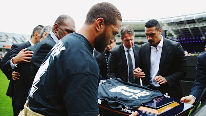 An official party carries the casket of former All Black player Jonah Lomu during a memorial service at Eden Park in Auckland