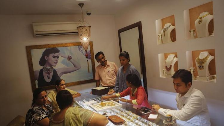 Customers shop inside a gold jewellery showroom in Mumbai