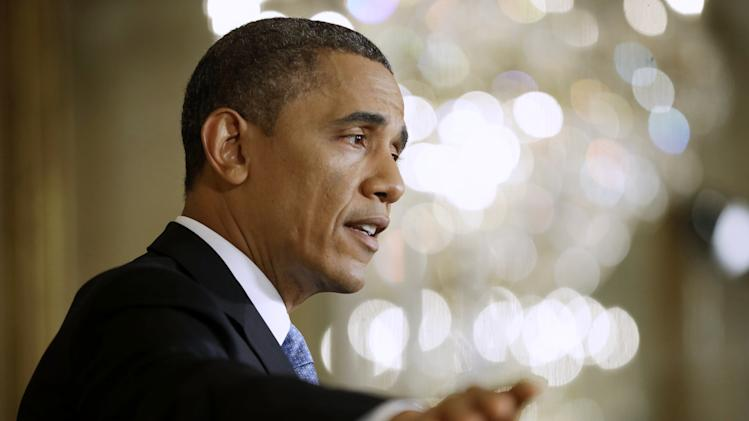 Obama unveils $500 million gun violence package