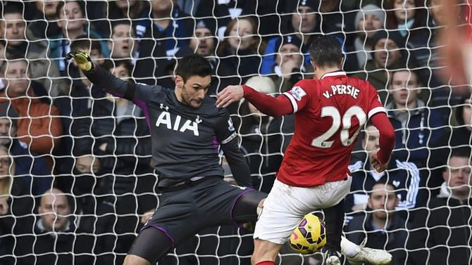 Manchester United's Robin van Persie fails to score past Tottenham Hotspur's Hugo Lloris during their English Premier League soccer match at White Hart Lane in London