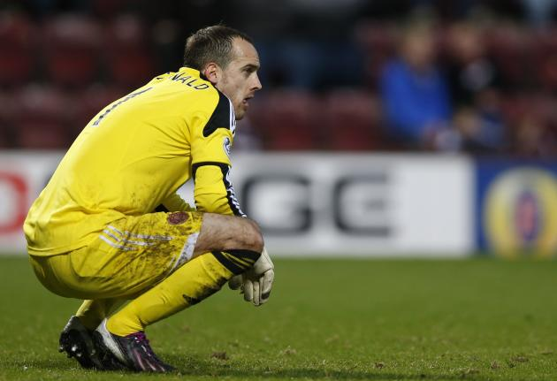 Heart of Midlothian's goalkeeper MacDonald reacts after conceding a goal against Celtic during their Scottish Cup fourth round soccer match at Tynecastle stadium, Edinburgh