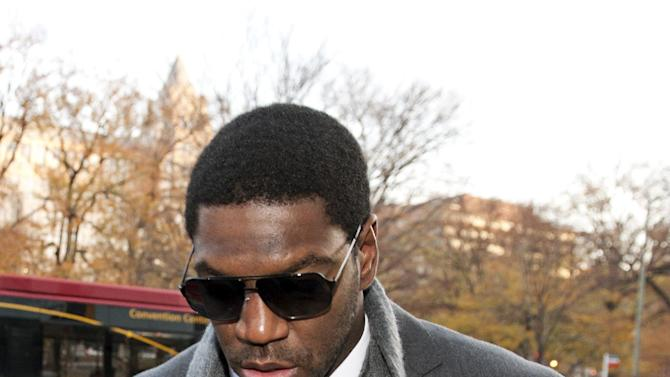 New Orleans Saints football linebacker Jonathan Vilma arrives at an attorney's office in Washington, Friday, Nov. 30, 2012, for a session of the pay-for-pain bounty system with the New Orleans Saints. Friday's session is part of the latest round of player appeals overseen by former NFL Commissioner Paul Tagliabue.  (AP Photo/Cliff Owen)