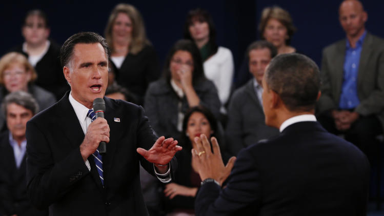 Republican presidential nominee Mitt Romney, left, addresses President Barack Obama  during the second presidential debate at Hofstra University, Tuesday, Oct. 16, 2012, in Hempstead, N.Y. (AP Photo/Pool-Shannon Stapleton)